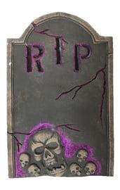 Серо-розовое надгробие с черепами