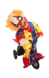 Яркий клоун на велосипеде