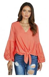 Коралловая блуза с узлом